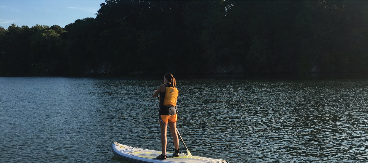 Student paddle boarding
